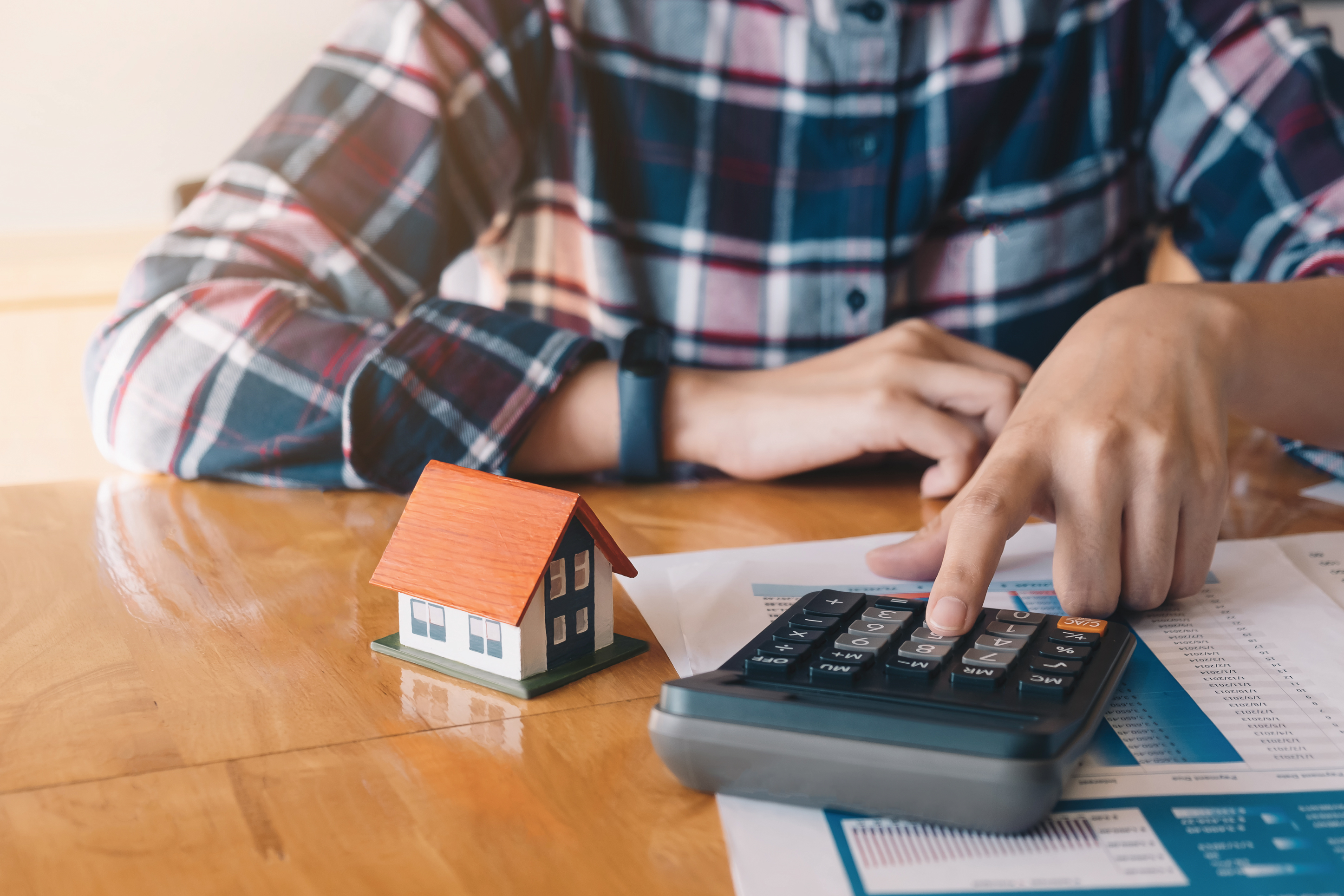 homeowner calculating a mortgage payment