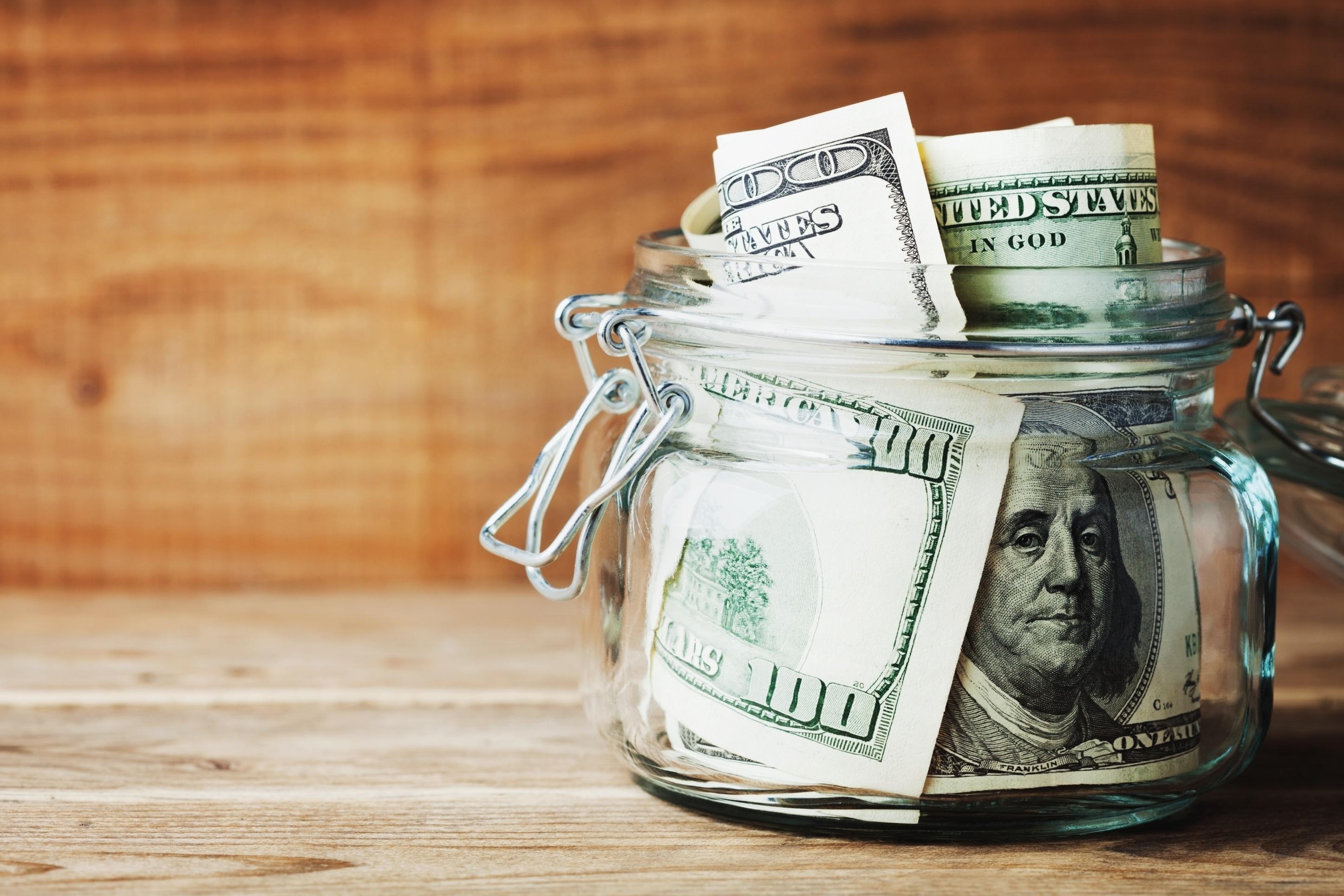 a jar of 100-dollar bills
