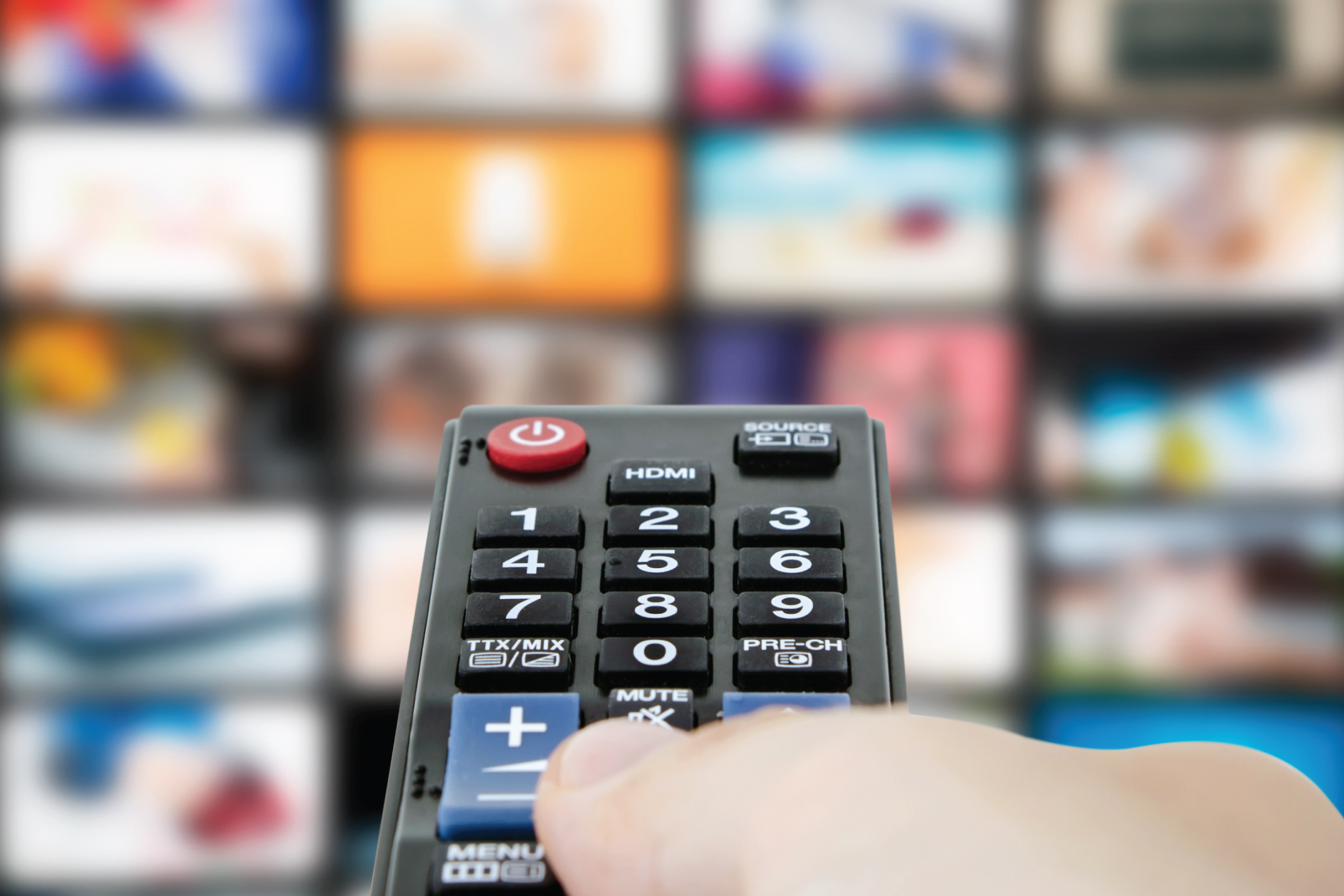 using a remote to select streaming services on a tv