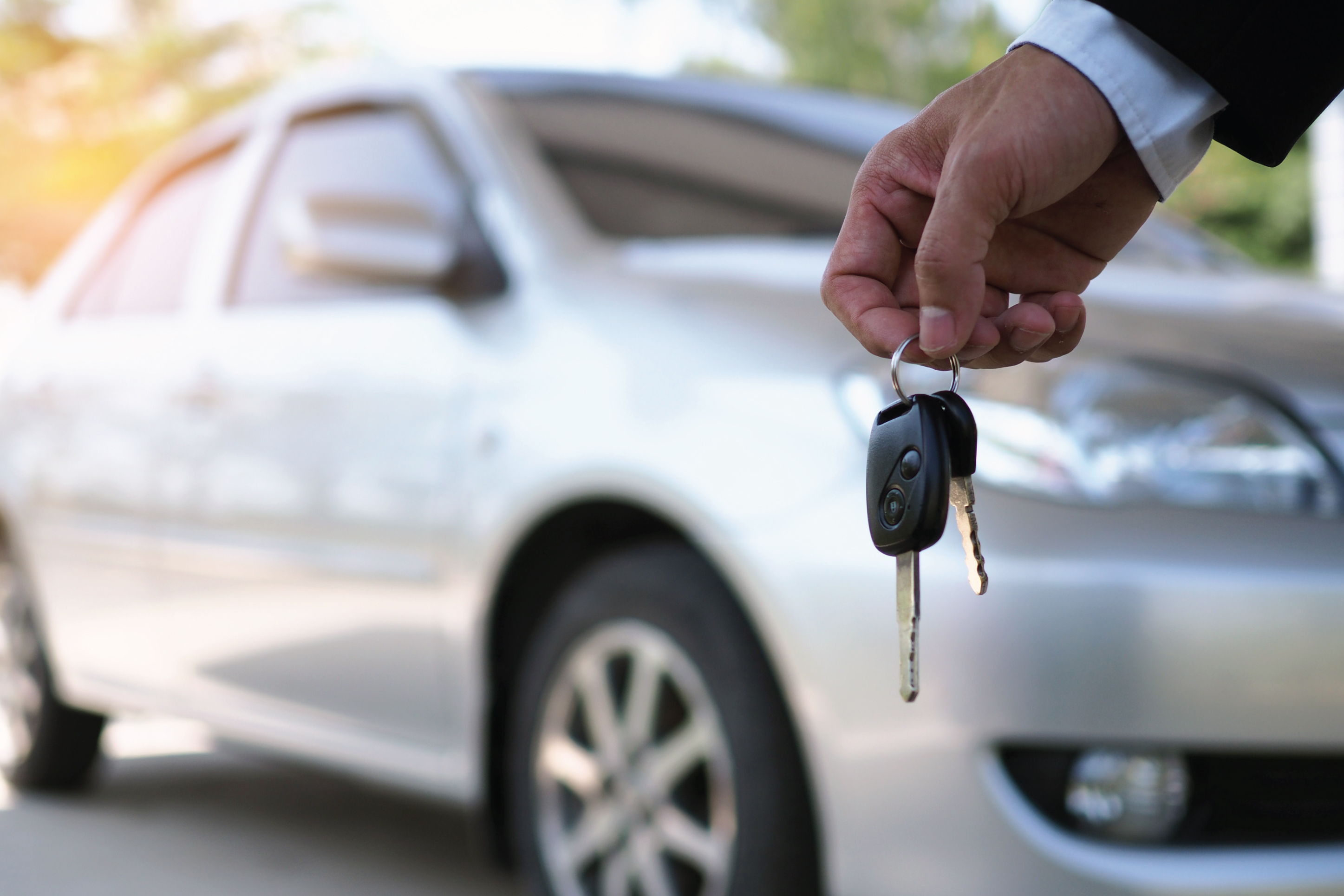 holding the keys to a car