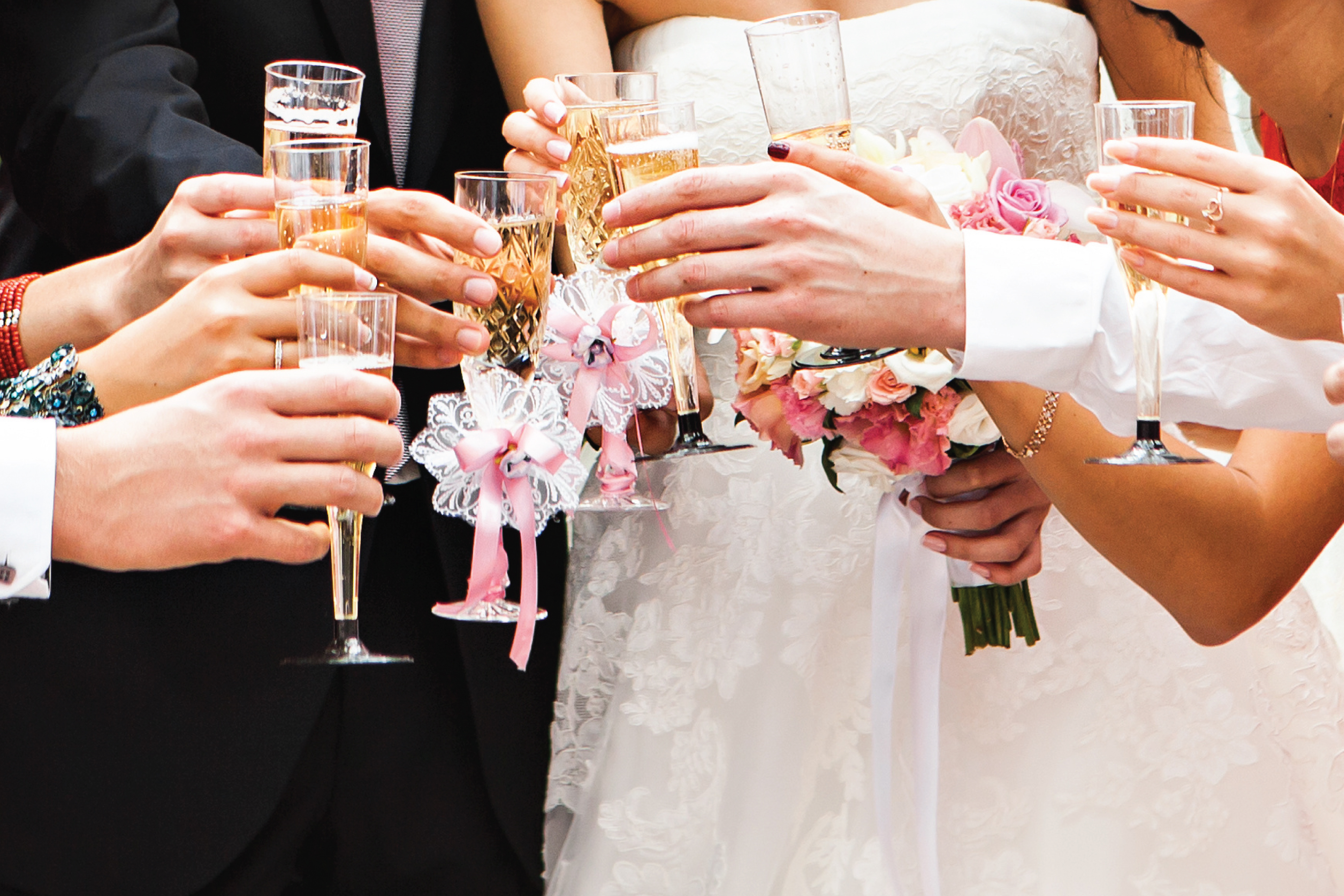 bride, groom and wedding party toasting with champagne