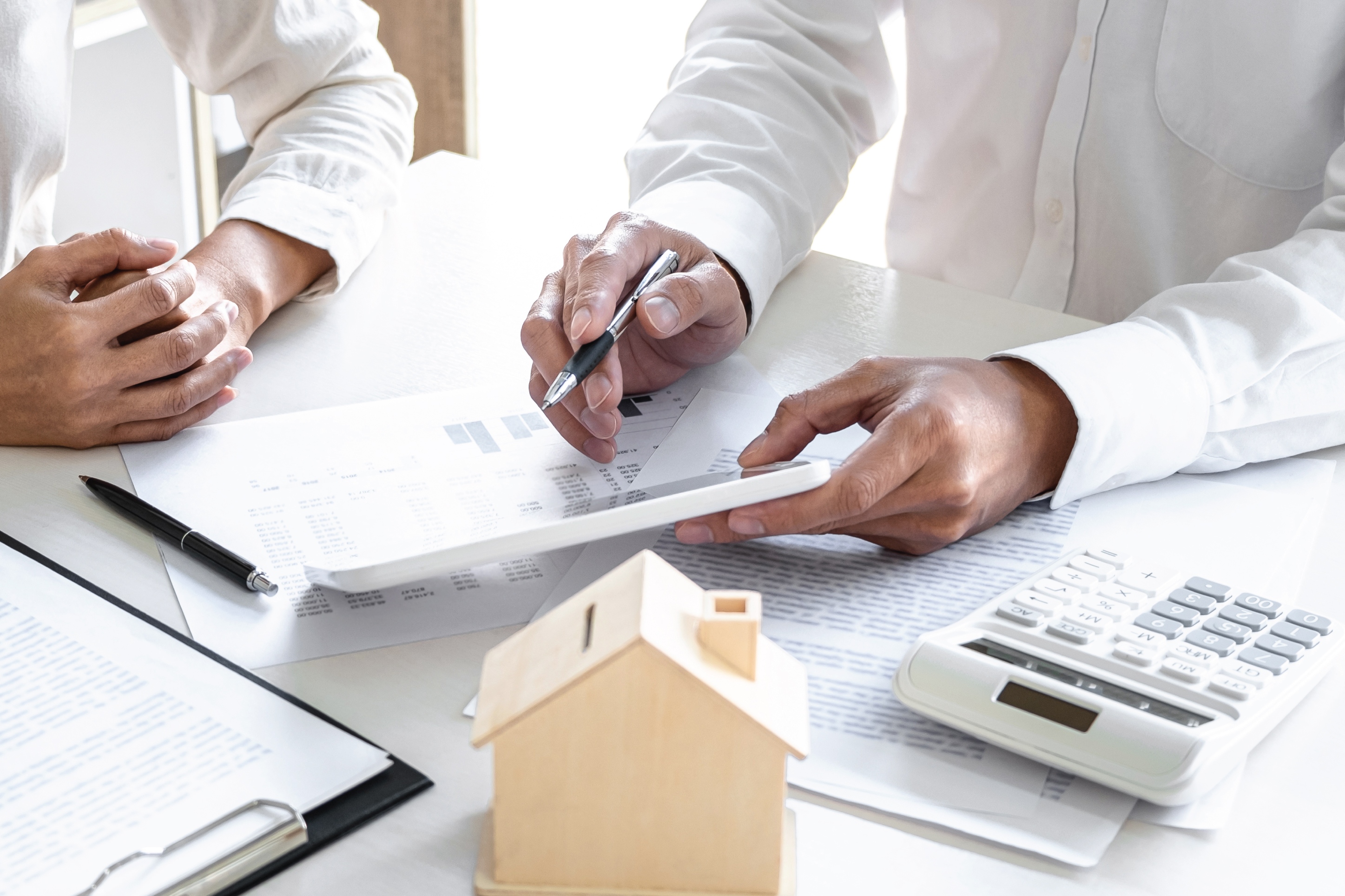 man pointing to homebuying documents